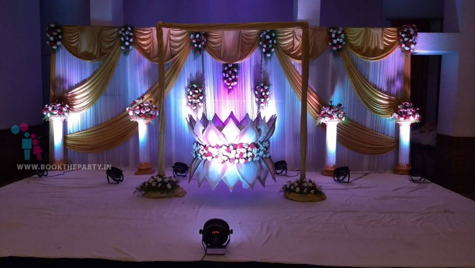 Lotus Cradle With White and Gold drapes Theme