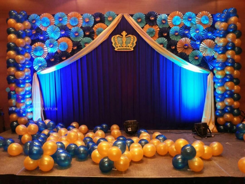 Blue Drapes with Paper Fans and Crown